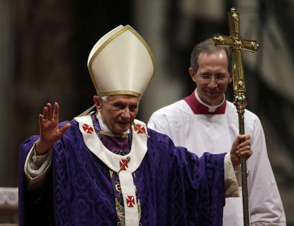 Pope Benedict XVI greets the faithful at the