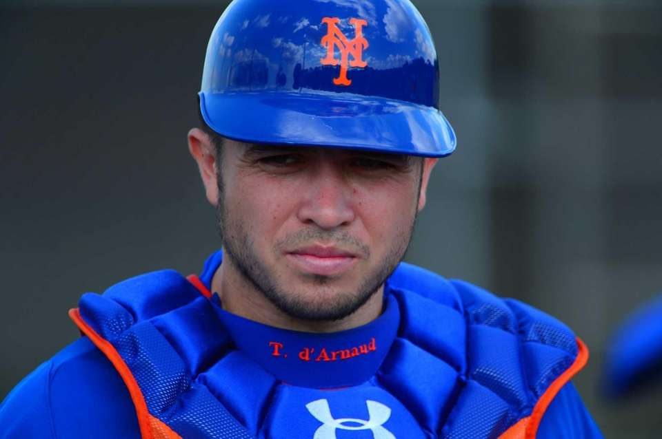 Travis d'Arnaud looks on during a spring training