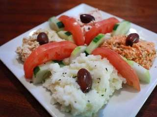 A plate of dips at Opa Grille might
