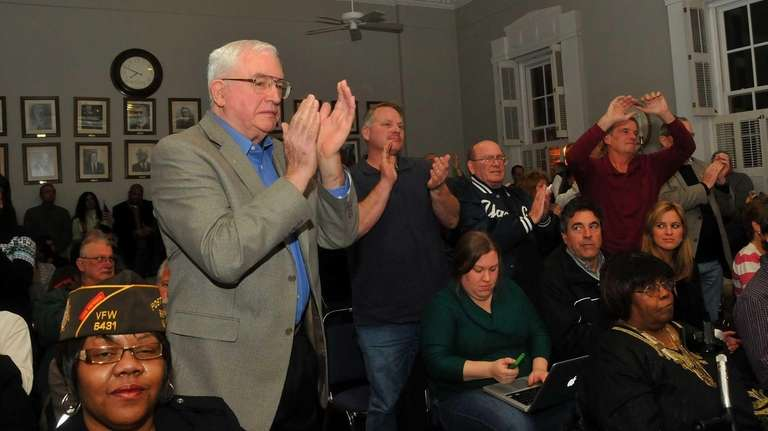 Community members clap in approval during Tuesday's Islip