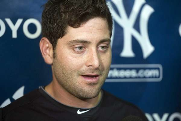 Francisco Cervelli talks to the media before working