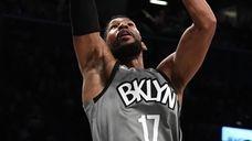 Nets guard Garrett Temple scores a layup against