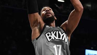 Nets guard Garrett Temple scores a layup against