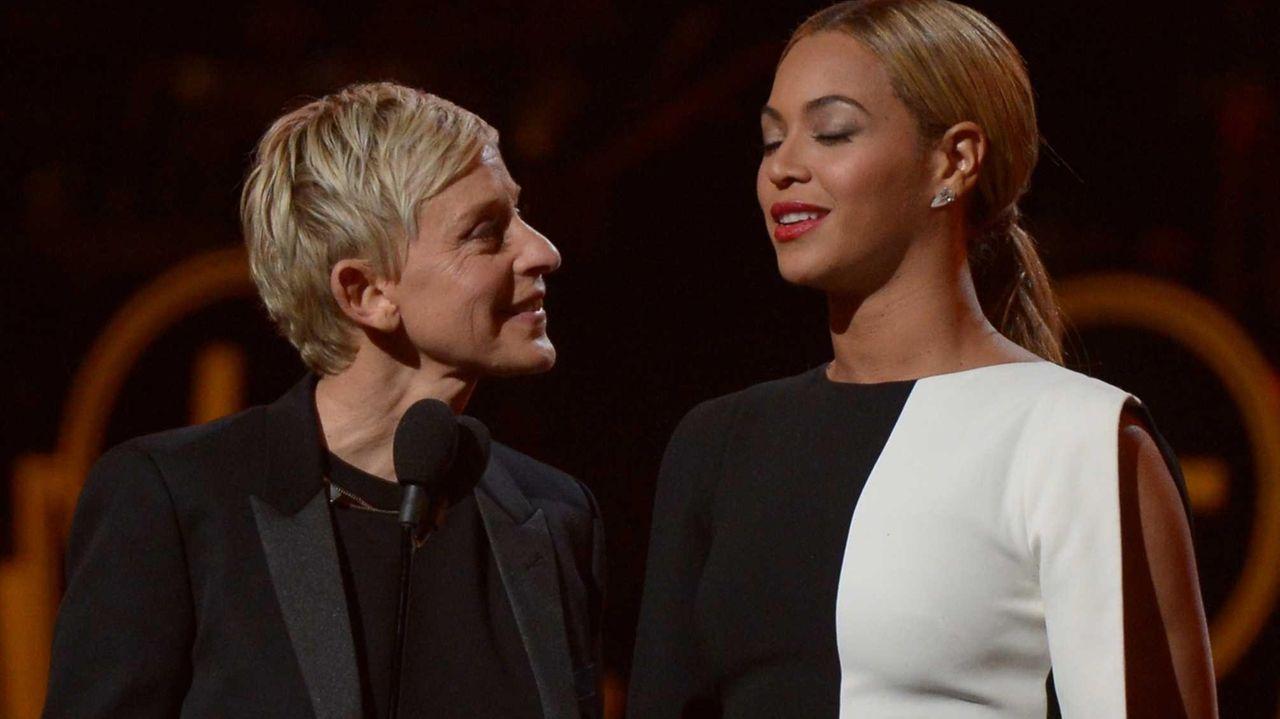 Ellen DeGeneres and Beyonce speak onstage at the