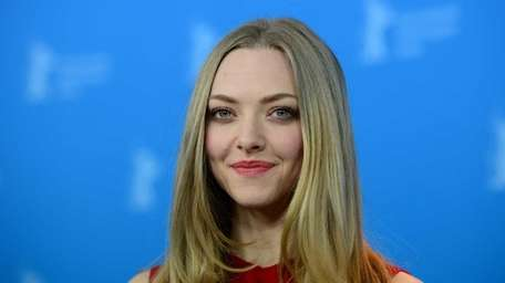 Amanda Seyfried poses at a photocall for the
