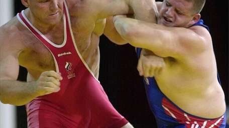 Rulon Gardner, right, of the United States, holds