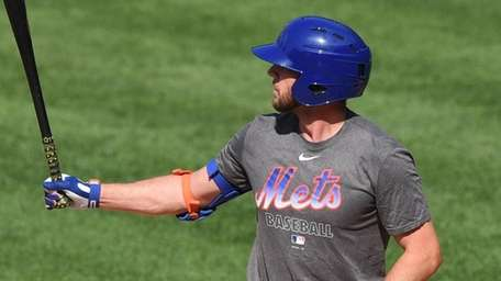 The Mets' Jed Lowrie bats in a simulated
