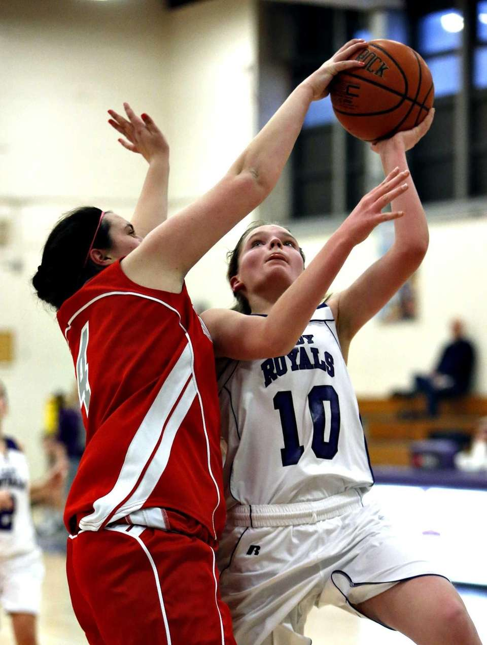 Southold's Melissa Rogers blocks the layup attempt of