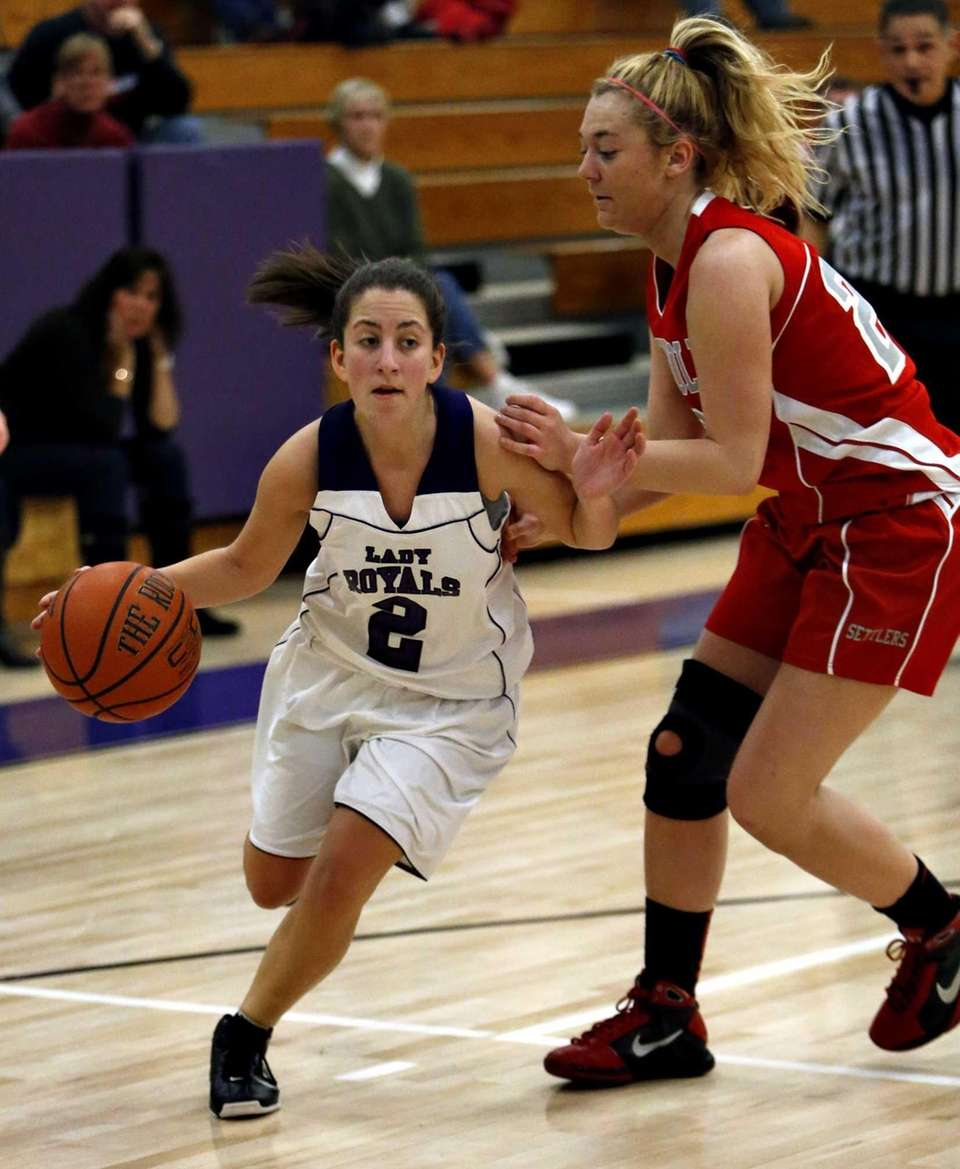 Port Jefferson's Rachel London drives against Southold's Sydney
