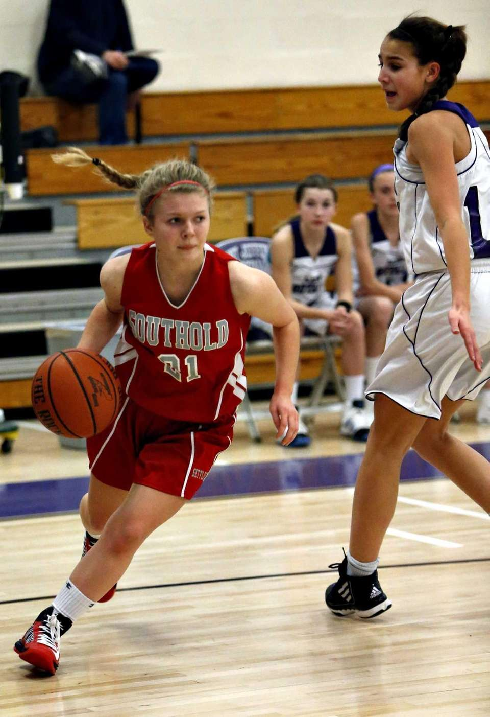 Southold's Justina Babcock drives around Port Jefferson's Corinne