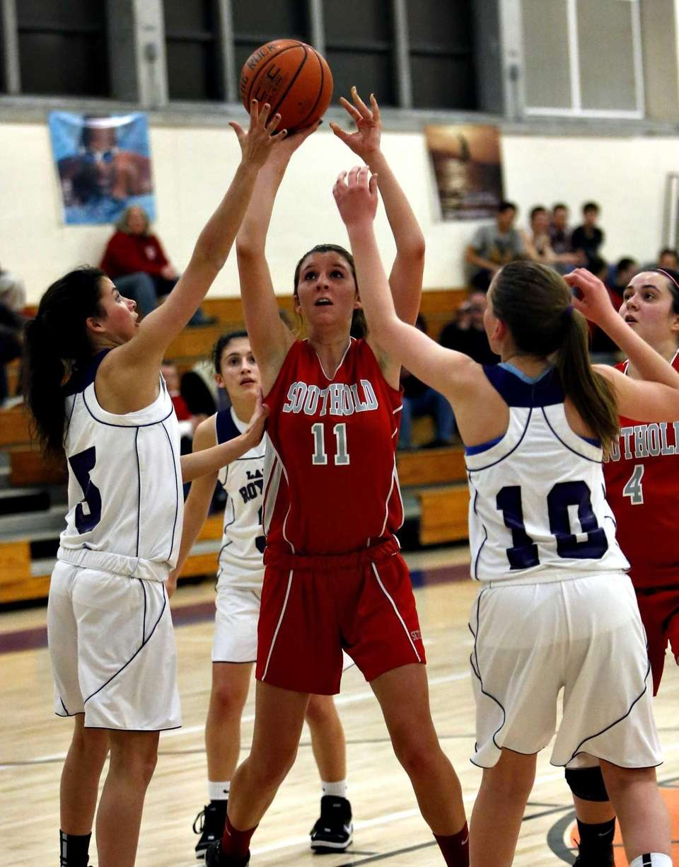 Southold's Nicole Busso goes for the jumper in