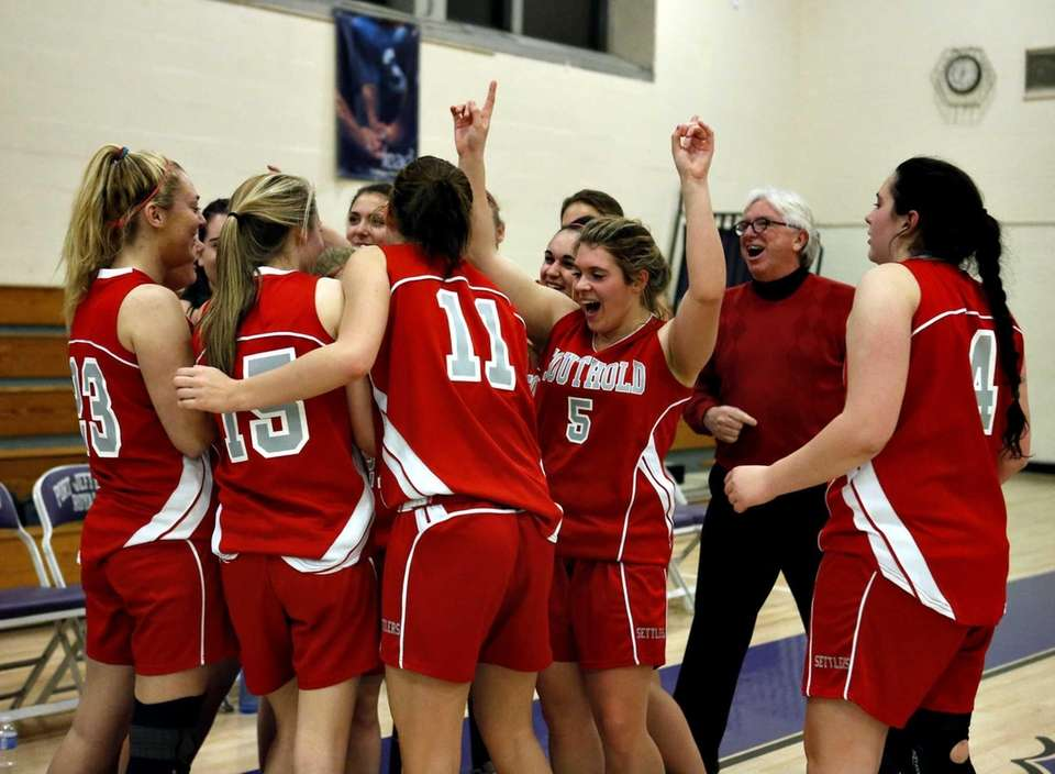 Southold's girls varsity basketball team celebrates after their
