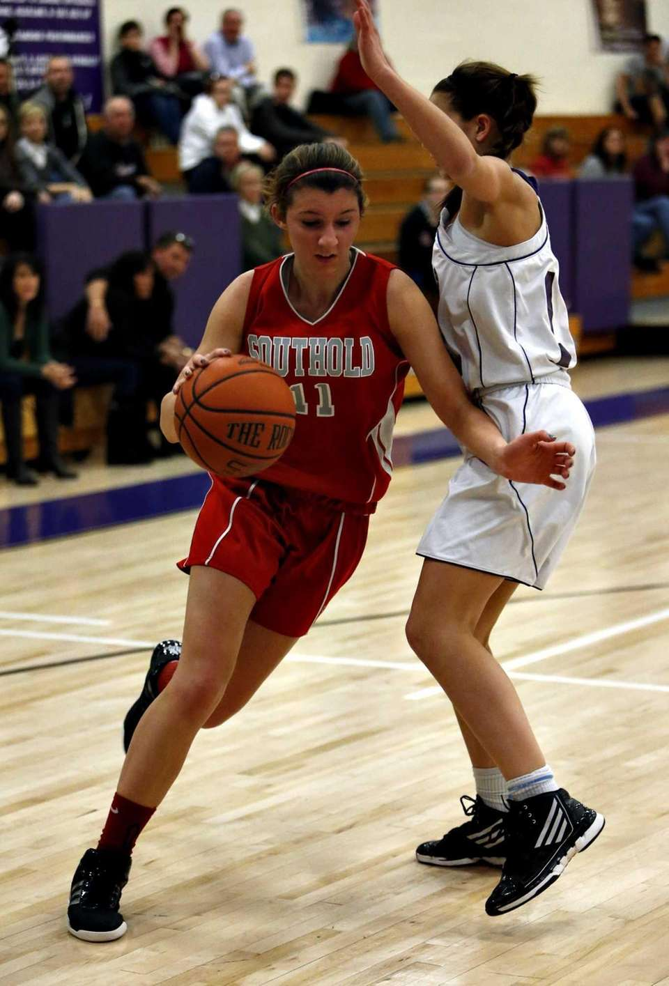 Southold's Nicole Busso drives into the paint against