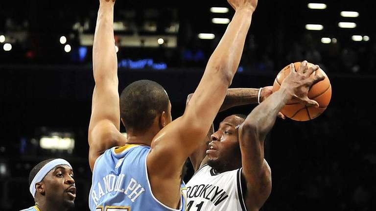 Ty Lawson and Anthony Randolph of the Nuggets