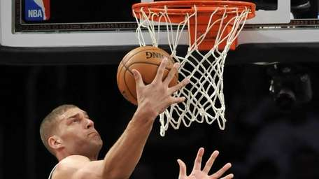 Brook Lopez pulls down a defensive rebound during
