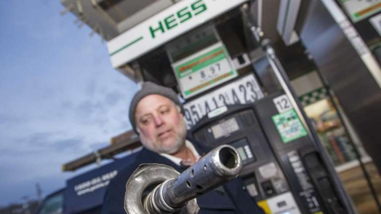 Bill Hayes, of Cutchogue, pumps gas at a