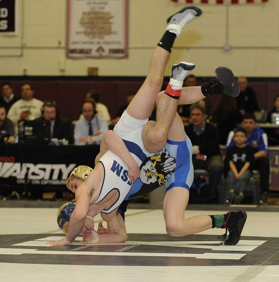 Hauppauge's Mark West, right, wrestles Eastport-South Manor's Jimmy