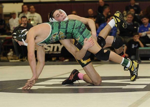 Ward Melville's Nick Piccininni wrestles Floyd's Mat Bradice
