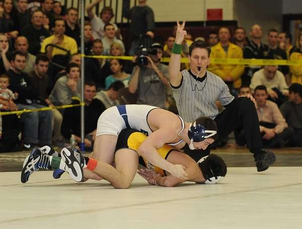 Eastport-South Manor's Travis Passaro wrestles Commack's Mike D'Angelo