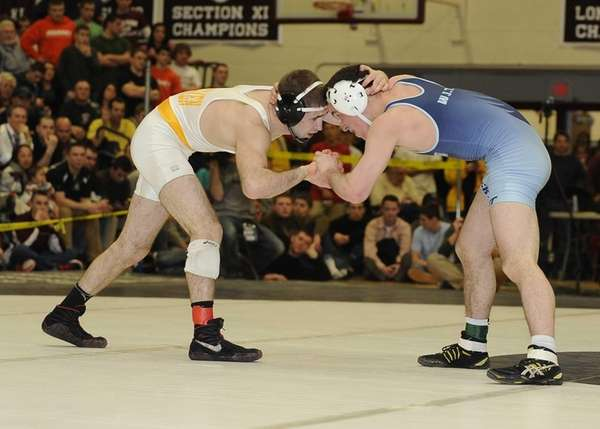 Rocky Point's Tommy Dutton wrestles Kings Park's Tom