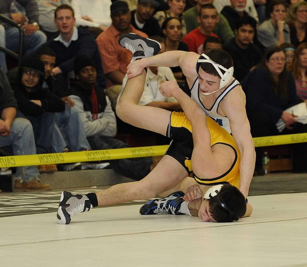 Eastport-South Manor's Travis Passaro wrestles Commack's Mike D'Angelo