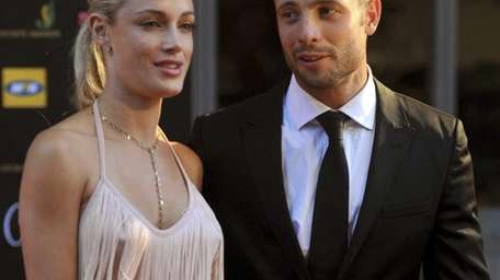 South African Olympic athlete Oscar Pistorius and girlfriend