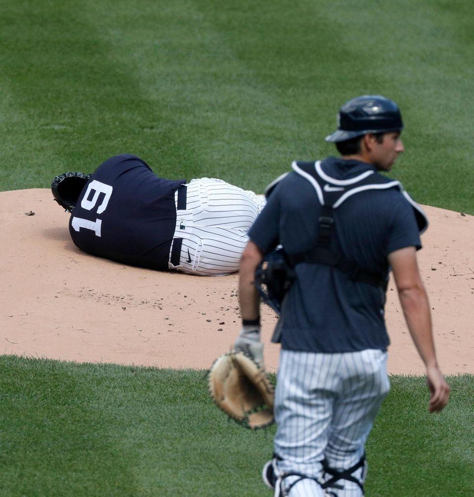 Masahiro Tanaka #19 of the Yankees lays on