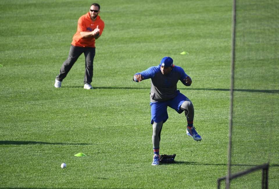 New York Mets' Yoenis Cespedes reacts to avoid