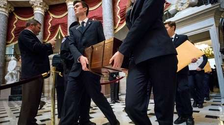 Senate pages carry the boxes containing the 2016
