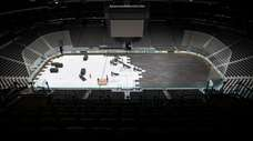 Crews cover the ice at American Airlines Center,