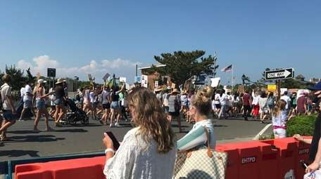 Vacationers watch as protesters filled the streets of