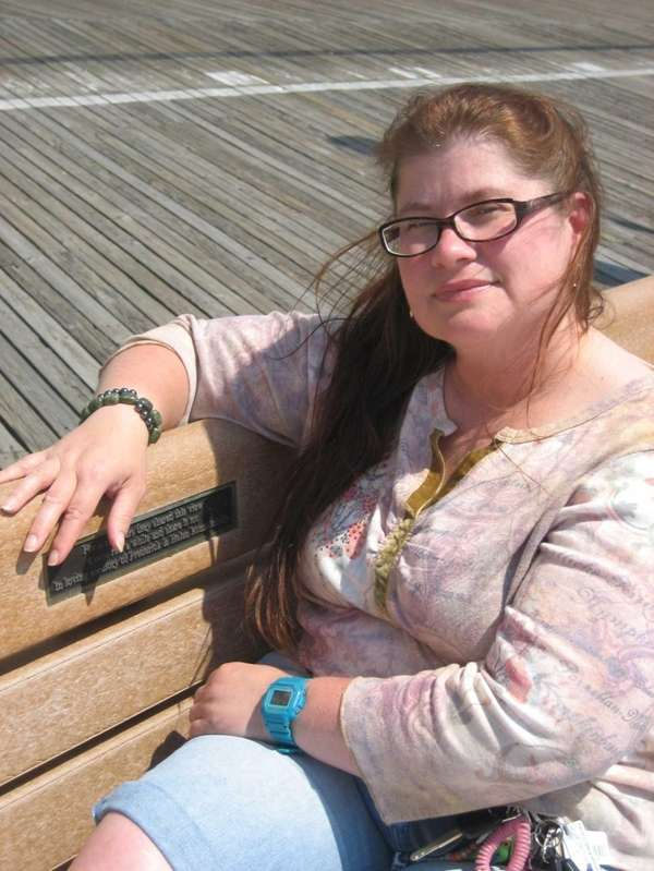 Wendy Phillips Engelhardt on the boardwalk bench dedicated