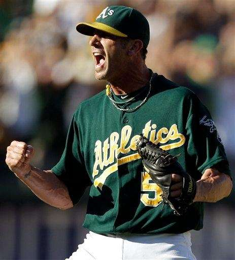 Oakland Athletics closer Grant Balfour reacts as the