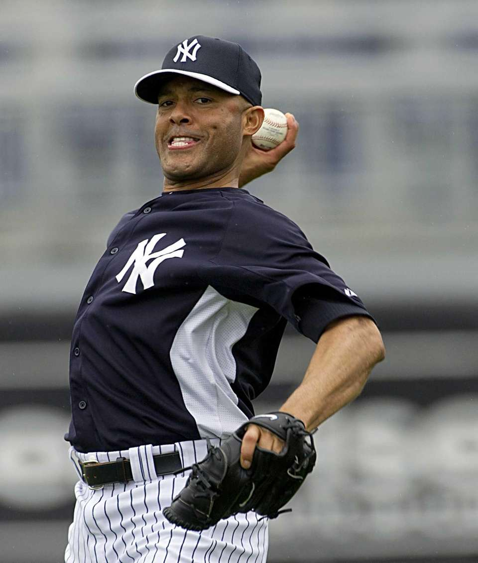 Mariano Rivera warms up his arm at George