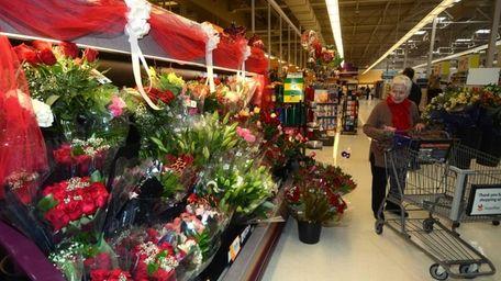 A customer checks out a large flower arrangement
