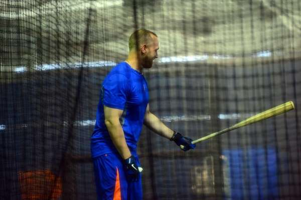 Andrew Brown takes batting practice during a spring