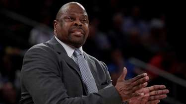 Georgetown head coach Patrick Ewing talks to his