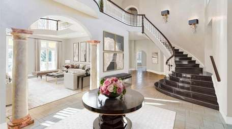 The house has a grand mahogany front staircase.