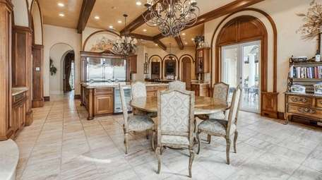 This sprawling, custom-built waterfront mansion in Old Field,