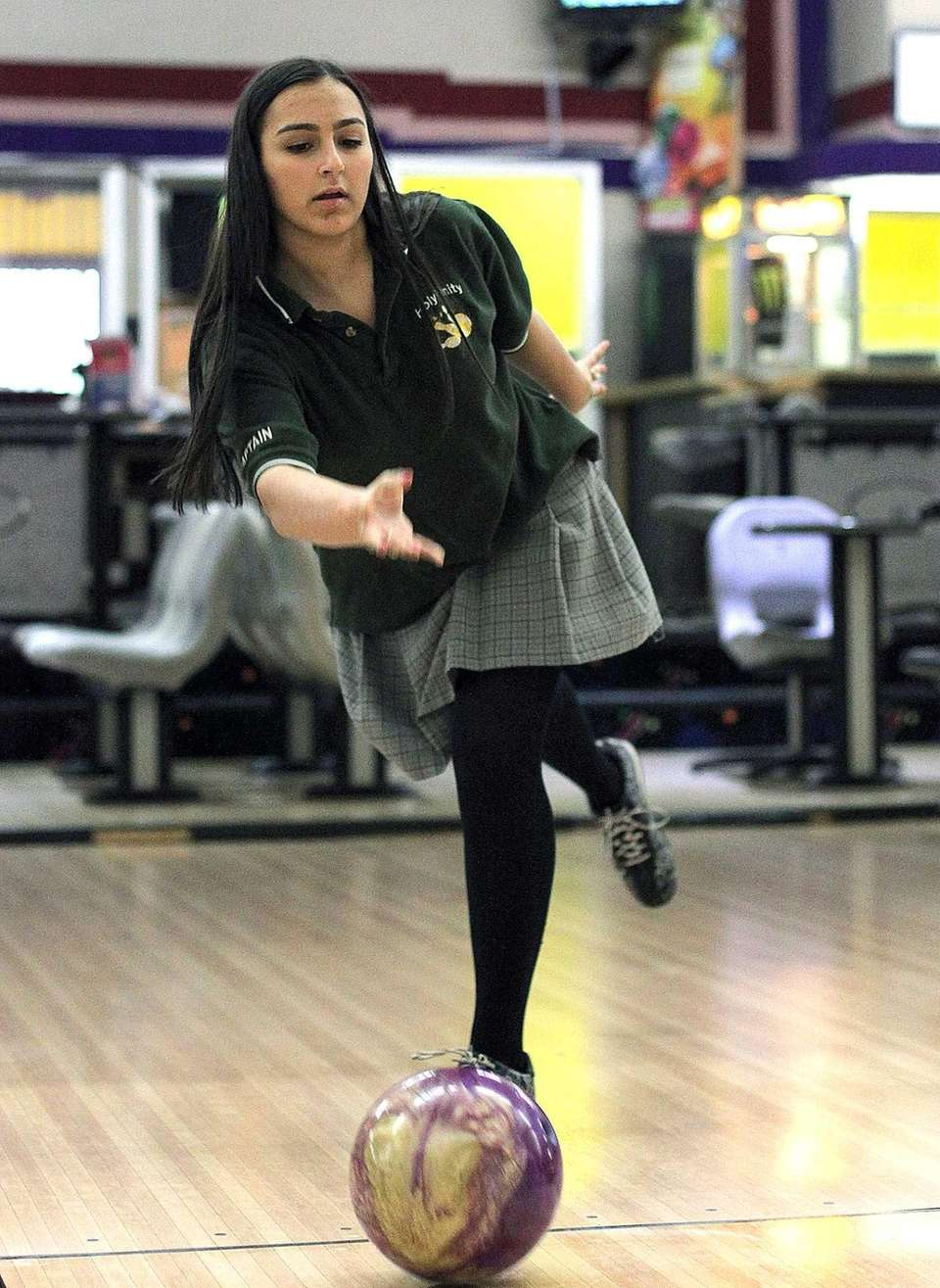 Holy Trinity's Geraldine Genovese tosses her ball down