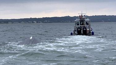 A Suffolk police Marine Bureau vessel tows a
