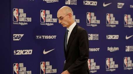 NBA Commissioner Adam Silver walks away from the