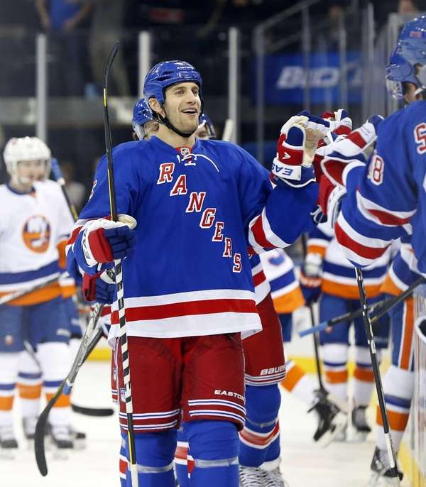 Dan Girardi celebrates his first period goal against