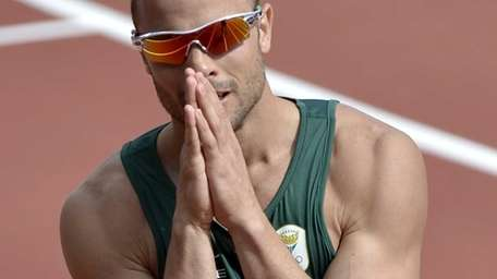 South Africa's Oscar Pistorius reacts after finishing first