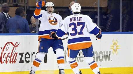 Colin McDonald of the Islanders celebrates his second