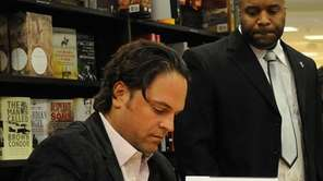 Retired All-Star catcher Mike Piazza signs copies of