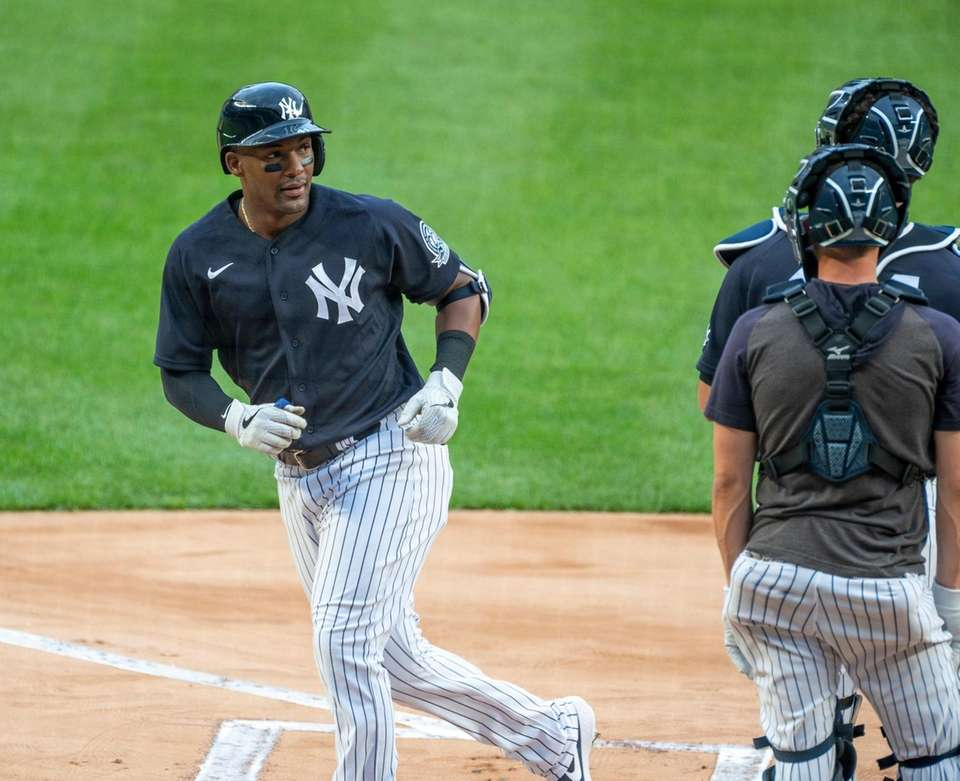 New York Yankees' Miguel Andújar round the bases