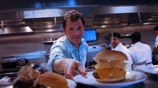 Chef Bobby Flay at his burger joint, Bobby's