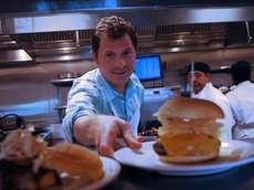 Chef Bobby Flay at his burger joint, Bobby's