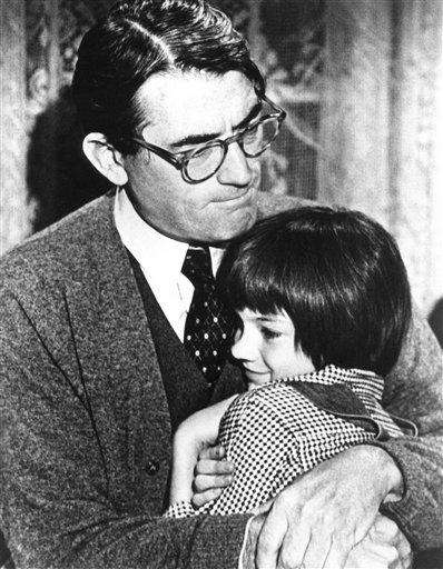 Mary Badham, 9, with Gregory Peck in